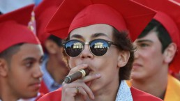 Graduation student smoking cigar red color