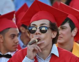 Graduation student smoking cigar red color