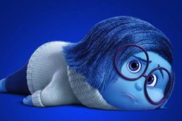Pixar Animation Studios Sadness movie inside out lying down sad